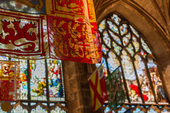 Flags and stained glass windows inside St Giles Cathedral Stock Photos