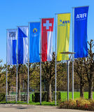 Flags at the entrance to the FIFA headquarters in Zurich Stock Photos