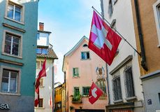 Flags on street in old town of Zurich Switzerland. Zurich, Switzerland - September 2, 2016: Flags on the street in the old town of Zurich, Switzerland stock image