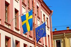 Flags of Sweden and the European Union at the Swedish house in S Stock Image
