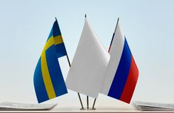 Flags of Sweden and Russia. Desktop flags of Sweden and Russia with a white flag in the middle royalty free stock photography