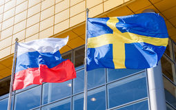 Flags of Sweden and Russia waving against IKEA store. SAMARA, RUSSIA - JUNE 14, 2015: Flags of Sweden and Russia waving against IKEA store royalty free stock images