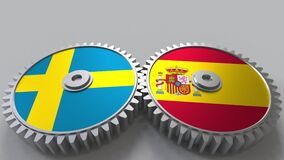 Flags of Sweden and Spain on meshing gears. International cooperation conceptual animation. Flags of Sweden and Spain on meshing gears. International cooperation stock footage