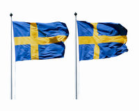 The flags of Sweden waving in the wind on the flagpoles  isolated on white. Two flags of Sweden waving in the wind on the flagpoles  isolated on white Stock Photo