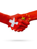 Flags Switzerland, China countries, partnership friendship handshake concept. Flags Switzerland, China countries, handshake cooperation, partnership, friendship Stock Photography