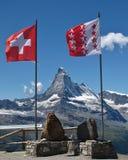 Flags of Switzerland and Wallis Canton, Matterhorn Royalty Free Stock Image