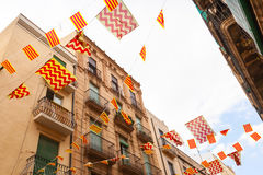 Flags of Tarragona city and Catalonia hanging over street Royalty Free Stock Photos
