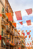 Flags of Tarragona city and Catalonia hanging over street Stock Photo