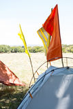 Flags on tents at festival site Royalty Free Stock Photo