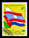 Flags, 30th anniversary of the Cuban revolution serie, circa 1989. MOSCOW, RUSSIA - MARCH 18, 2018: A stamp printed in Lao People`s Democratic Republic shows royalty free stock photo