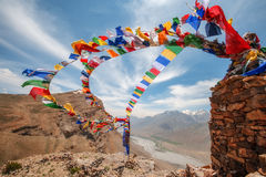 Flags. Tibetan flags with mantra on sky background Stock Photos