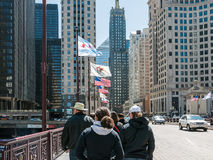 Flags and tourists on Michigan Ave. Bridge in chicago Stock Photography