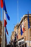 Flags and town buildings, Valletta. Stock Photography