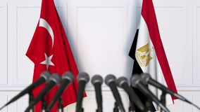 Flags of Turkey and Egypt at international meeting or negotiations press conference. 3D animation stock video