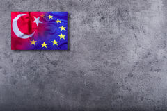 Flags of the Turkey and the European Union on concrete background Royalty Free Stock Images