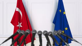 Flags of Turkey and the European Union at international meeting or negotiations press conference. 3D animation stock video footage