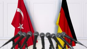 Flags of Turkey and Germany at international meeting or negotiations press conference. 3D animation stock footage