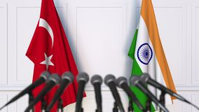 Flags of Turkey and India at international meeting or negotiations press conference. 3D animation stock video