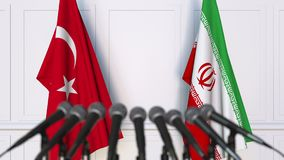Flags of Turkey and Iran at international meeting or negotiations press conference. 3D animation stock video
