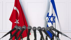 Flags of Turkey and Israel at international meeting or negotiations press conference. 3D animation stock footage
