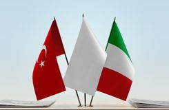 Flags of Turkey and Italy. Desktop flags of Turkey and Italy with a white flag in the middle royalty free stock photos