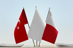 Flags of Turkey and Malta. Desktop flags of Turkey and Malta with a white flag in the middle royalty free stock images