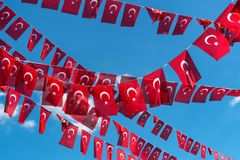 Flags of Turkey over blue sky background royalty free stock photos