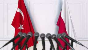 Flags of Turkey and Poland at international meeting or negotiations press conference. 3D animation stock video footage