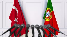 Flags of Turkey and Portugal at international meeting or negotiations press conference. 3D animation stock footage