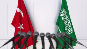 Flags of Turkey and Saudi Arabia at international meeting or negotiations press conference. 3D animation stock footage