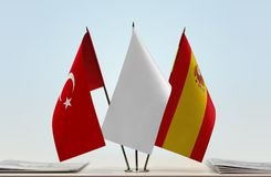 Flags of Turkey and Spain. Desktop flags of Turkey and Spain with a white flag in the middle royalty free stock image