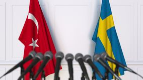 Flags of Turkey and Sweden at international meeting or negotiations press conference. 3D animation stock video footage