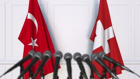 Flags of Turkey and Switzerland at international meeting or negotiations press conference. 3D animation stock video footage