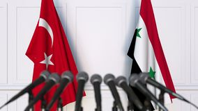 Flags of Turkey and Syria at international meeting or negotiations press conference. 3D animation stock video footage