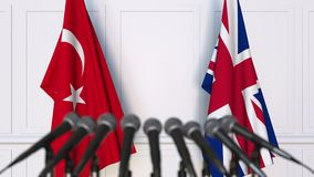Flags of Turkey and The United Kingdom at international meeting or negotiations press conference. 3D animation stock video footage