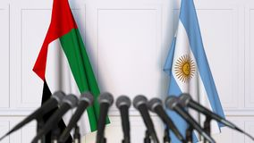 Flags of the UAE and Argentina at international meeting or negotiations press conference. 3D animation stock footage
