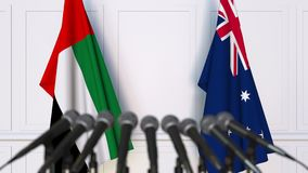Flags of the UAE and Australia at international meeting or negotiations press conference. 3D animation stock video