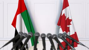 Flags of the UAE and Canada at international meeting or negotiations press conference. 3D animation stock video footage