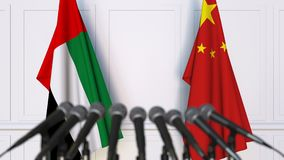 Flags of the UAE and China at international meeting or negotiations press conference. 3D animation stock video
