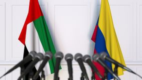 Flags of the UAE and Colombia at international meeting or negotiations press conference. 3D animation stock video