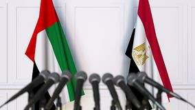 Flags of the UAE and Egypt at international meeting or negotiations press conference. 3D animation stock video footage
