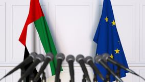 Flags of the UAE and the European Union at international meeting or negotiations press conference. 3D animation stock footage