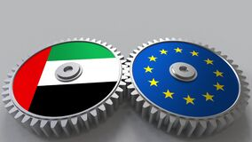 Flags of the UAE and the European Union on meshing gears. International cooperation conceptual animation stock video