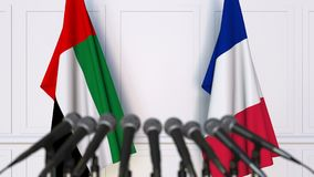 Flags of the UAE and France at international meeting or negotiations press conference. 3D animation stock video