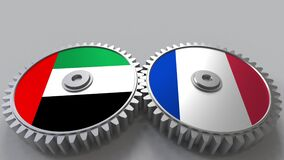Flags of the UAE and France on meshing gears. International cooperation conceptual animation stock video