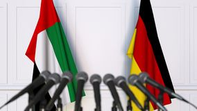 Flags of the UAE and Germany at international meeting or negotiations press conference. 3D animation stock video