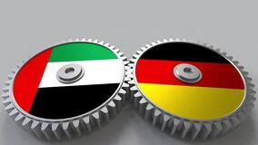 Flags of the UAE and Germany on meshing gears. International cooperation conceptual animation. Flags of the UAE and Germany on meshing gears. International stock footage