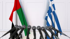 Flags of the UAE and Greece at international meeting or negotiations press conference. 3D animation stock video