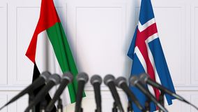 Flags of the UAE and Iceland at international meeting or negotiations press conference. 3D animation stock video