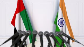 Flags of the UAE and India at international meeting or negotiations press conference. 3D animation stock footage